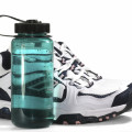 athletic shoes and water bottle
