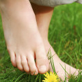child's bare feet in grass