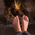 feet by a fire